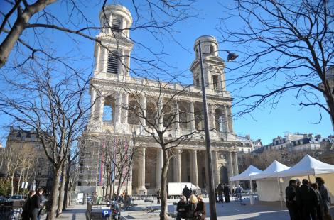 People stroll in front of the Saint Sulpice church on January 16, 2011 in Paris. The northern...